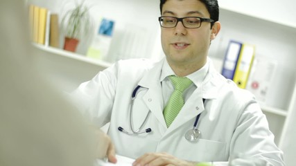 Young Doctor Giving Apple Patient Health Concept