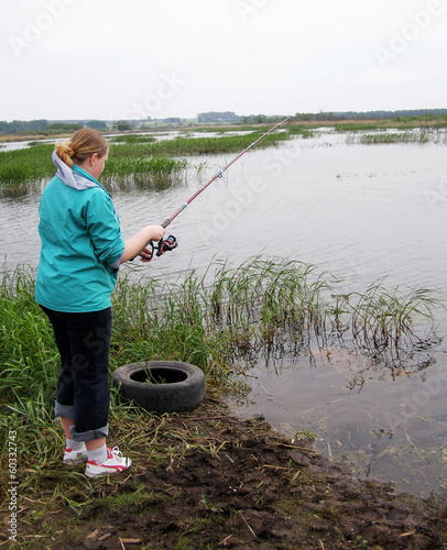 Girl with a fishing rod