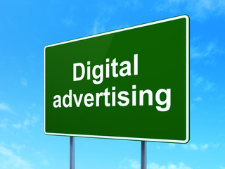 Marketing concept: Digital Advertising on road sign background