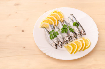 Fresh smelt on ice with lemon