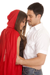 man and red riding hood arms around each other