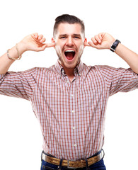 Frustrated Casual young man closing his ears with his hands