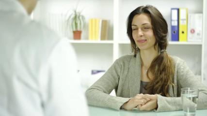 Beautiful Young Woman Recieving RX Prescription Doctors Office