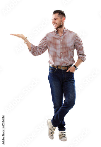 Happy smiling young man presenting  text or product isolated