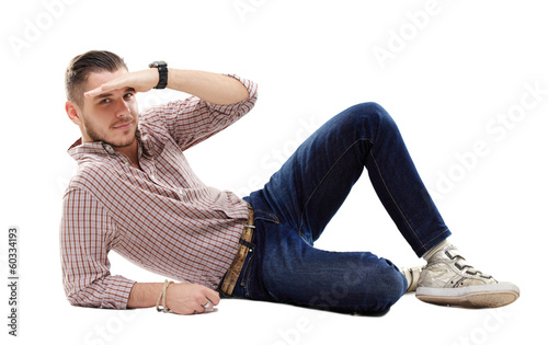 Flirtatious man sitting on the floor