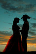 silhouette couple he hold her close