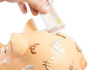 hand inserting euro in piggy bank, concept for save money