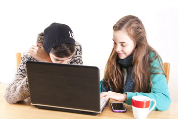 young teenagers with computer and phone happy