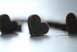 Little brown hearts on wooden background