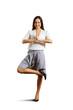 smiley businesswoman practicing yoga