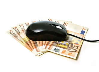computer mouse on banknotes