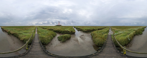 Westerhever lighthouse in the cloudy evening