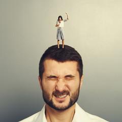 woman shouting at megaphone at dissatisfied man
