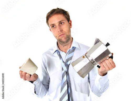 messy business man with hangover holding coffee pot
