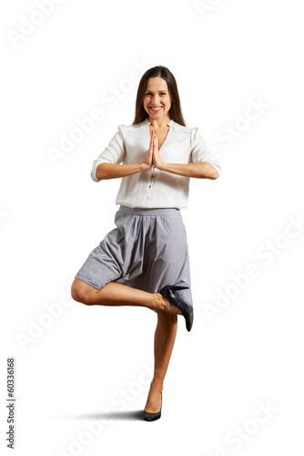 smiley businesswoman practicing yoga