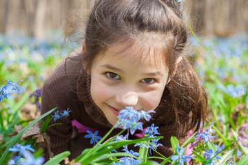 Smiling girl among the bluebells