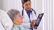 Woman doctor explaining brain scans to mature patient