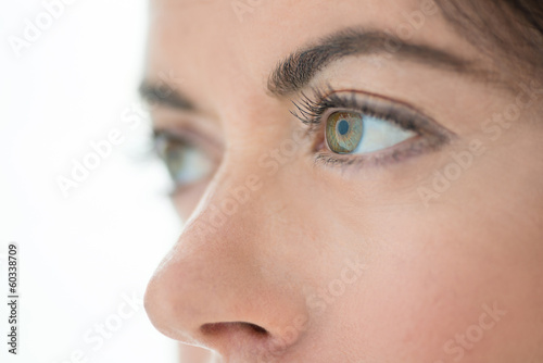 close up of the eyes of a beautiful mature lady looking away