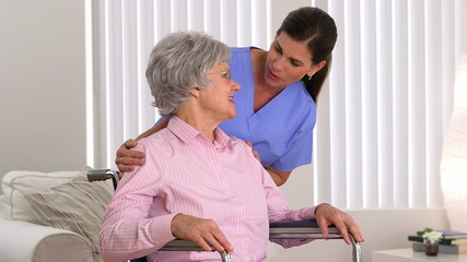 Disabled patient talking with caregiver