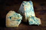 Stilton mature blue mouldy cheese - Dark background