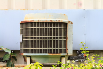 Old condensing unit behind the biulding