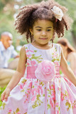 Closeup portrait of little mulatto girl in beautiful gown
