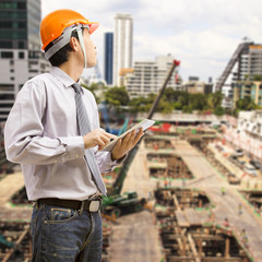Engineers and architects using digital tablet