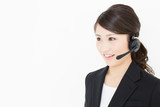 young asian businesswoman on with headset