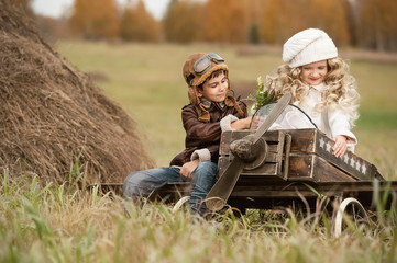 Children with a model airplane field