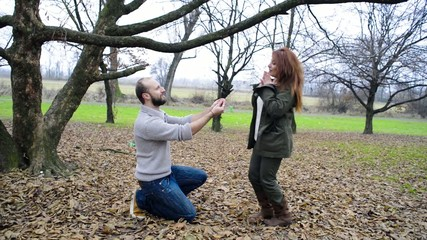 marriage proposal couple outdoor park winter valentine