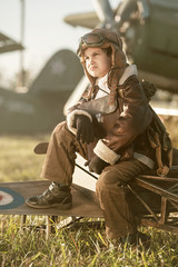 Portrait of a young aviator parked aircraft
