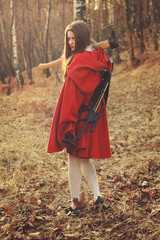 Little red riding hood posing with axe