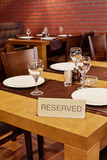 Served table with sign Reserved in restaurant