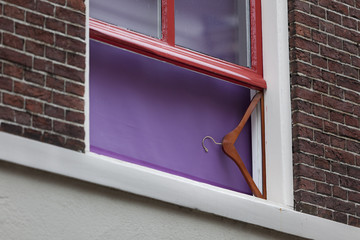 Coat hanger as window support