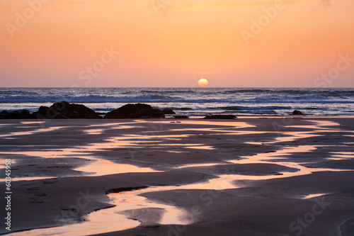 Sunset reflections on Porthtown Beach