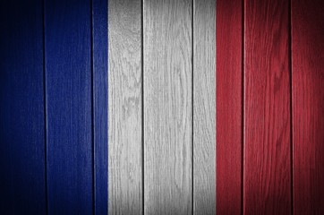 france flag painted on old wood plank background