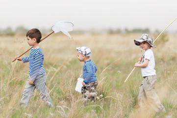 Children on walk on a meadow