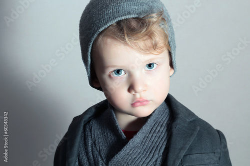Fashionable Little Boy in Cap.Fashion Handsome blond Child