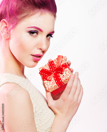girl holding a box with a gift
