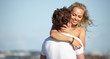 couple in love on the beach flirting