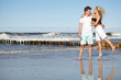 Happy young couple on the beach.Valentines day