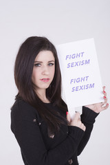 Fight Sexism young woman holding protest notice
