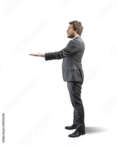 Businessman holding something in hand