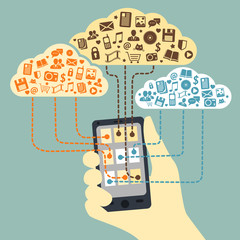 Hand holding smartphone connected to cloud services