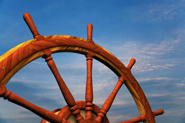 boat steering wheel against sky