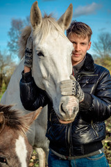 Man and horses outdoors