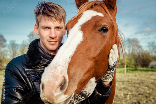 Man and horse outdoors