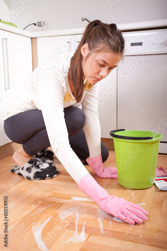 Young woman cleaning and doing housework