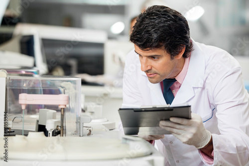 Scientist Observing Experiment