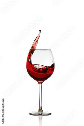 Red Wine Splashing in Glas